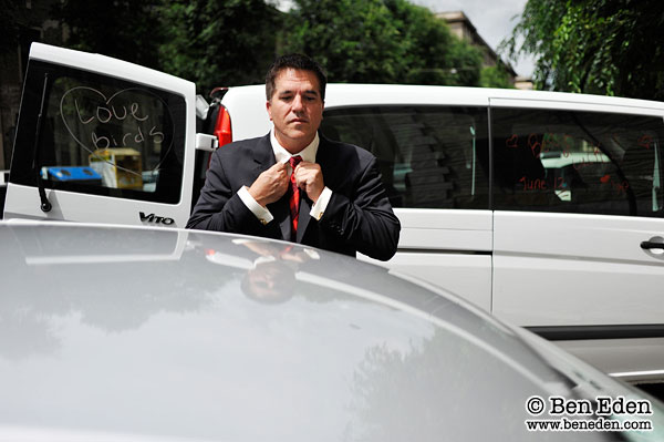 American groom gets ready for a wedding ceremony in Rome, Italy