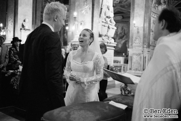 Photograph of a German couple getting wed at the Santa Maria dell'Anima church in Rome, Italy