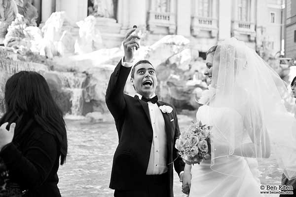 Turkish Newlyweds throwing a coin into the Fontana di Trevi in Rome