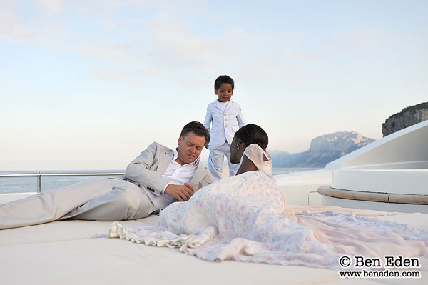 Photograph of a Bride and Groom as they relax on a yacht anchored at the Golfo di Orosei in Sardinia, Italy