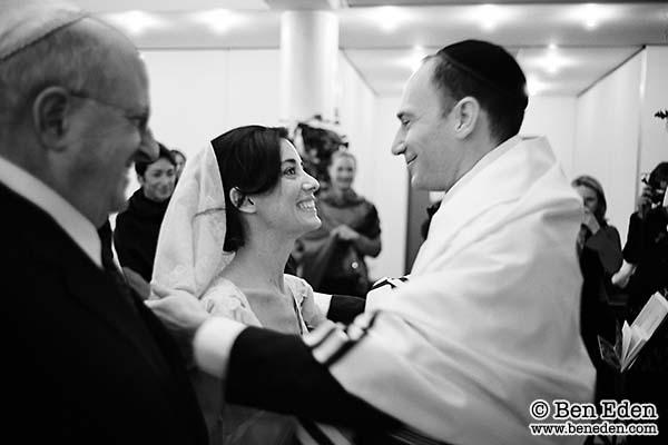 Jewish Groom Lifts His Brides Veil