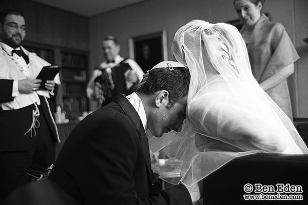 Photograph of a Jewish Bride and Groom getting ready before their wedding ceremony