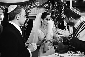 Photographs of bride and groom signing the Ketubah